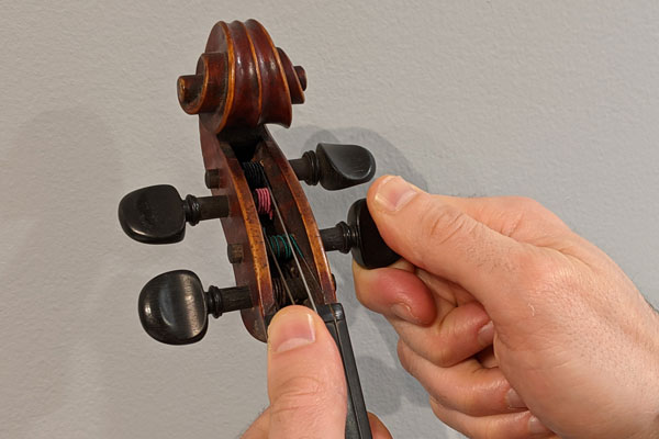 Use the pegs of the violin for course tuning